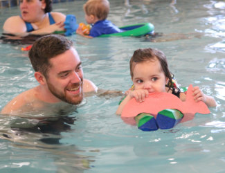 Staff in the pool with Ellie
