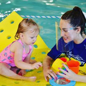 Atlanta Swim Academy instructor in the pool with a student.